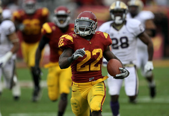 RB Curtis McNeal looks for some big runs against UCLA like this 79 yard TD run against Washington