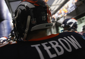 DENVER, CO - NOVEMBER 17:  Quarterback Tim Tebow #15 of the Denver Broncos prepares to take the field to face the New York Jets at Sports Authority Field at Mile High on November 17, 2011 in Denver, Colorado. The Broncos defeated the Jets 17-13.  (Photo b