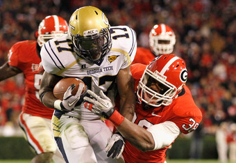 ATHENS, GA - NOVEMBER 27:  Marcus Dowtin #38 of the Georgia Bulldogs tackles Orwin Smith #17 of the Georgia Tech Yellow Jackets at Sanford Stadium on November 27, 2010 in Athens, Georgia.  (Photo by Kevin C. Cox/Getty Images)