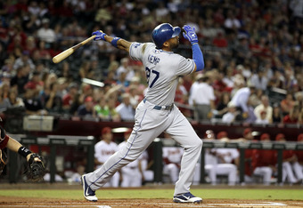 PHOENIX, AZ - SEPTEMBER 26:  Matt Kemp #27 of the Los Angeles Dodgers hits a three run home run against the Arizona Diamondbacks during the first inning of the Major League Baseball game at Chase Field on September 26, 2011 in Phoenix, Arizona.  (Photo by