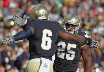 SOUTH BEND, IN - OCTOBER 29: Jonas Gray #25 of the Notre Dame Fighting Irish celebrates a touchdown run with Theo Riddick #6 against the Navy Midshipmen at Notre Dame Stadium on October 29, 2011 in South Bend, Indiana. (Photo by Jonathan Daniel/Getty Imag