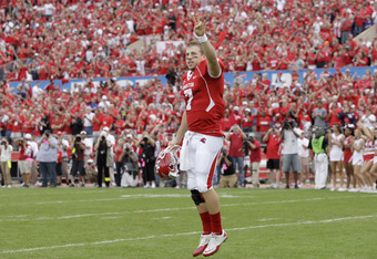 HOUSTON, TX - NOVEMBER 19: Quarterback Case Keenum #7 of the Houston Cougars waves to the fans after being introduced on Senior Day before UH played against  Southern Methodist University Mustangs on November 19, 2011 at Robertson Stadium in Houston, Texa
