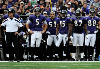BALTIMORE, MD - NOVEMBER 20: Coach John Harbaugh of the Baltimore Ravens, quarterback Joe Flacco #5 of the Baltimore Ravens and teammates look on after the Cincinnati Bengals score in the first quarter at M&T Bank Stadium on November 20, 2011 in Baltimore