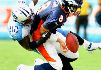 NASHVILLE, TN - SEPTEMBER 25: Will Witherspoon #92 of the Tennessee Titans forces Kyle Orton #8 of the Denver Broncos to fumble out-of-bounds at LP Field on September 25, 2011 in Nashville, Tennessee. Tennessee won 17-14. (Photo by Grant Halverson/Getty I