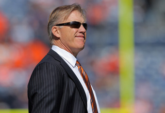 October 9, 2011: John Elway surveys the field before a game against the Chargers in Denver.