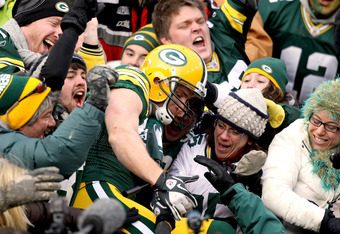 GREEN BAY, WI - NOVEMBER 20:  Jordy Nelson #87 of the Green Bay Packers leaps into the bleachers after scoring a touchdown against the Tampa Bay Buccaneers at Lambeau Field on November 20, 2011 in Green Bay, Wisconsin.  (Photo by Matthew Stockman/Getty Im