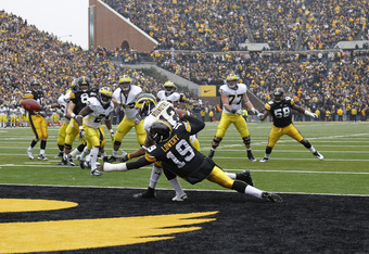 IOWA CITY, IA - NOVEMBER 5: B.J. Lowery #19 of the Iowa Hawkeyes defends the final pass of the game against Roy Roundtree #12 of the Michigan Wolverines at Kinnick Stadium on November 5, 2011 in Iowa City, Iowa. Iowa held on to win 24-16. (Photo by Joe Ro
