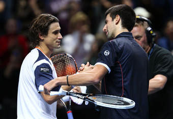 LONDON, ENGLAND - NOVEMBER 23:  David Ferrer of Spain greets Novak Djokovic of Serbia after the   men's singles match during the Barclays ATP World Tour Finals at the O2 Arena on November 23, 2011 in London, England.  (Photo by Julian Finney/Getty Images)