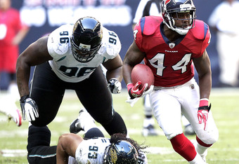 HOUSTON - OCTOBER 30:  Running back Ben Tate #44 of the Houston Texans rushes past defensive tackle Tyson Alualu #93 and Terrance Knighton #96 of the Jacksonville Jaguars at Reliant Stadium on October 30, 2011 in Houston, Texas.  (Photo by Bob Levey/Getty