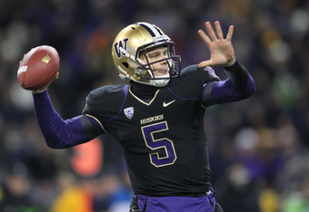 SEATTLE - NOVEMBER 05:  Quarterback Nick Montana #5 of the Washington Huskies throws a 53 yard pass against the Oregon Ducks on November 5, 2011 at Husky Stadium in Seattle, Washington. The Ducks defeated the Huskies 34-17. (Photo by Otto Greule Jr/Getty