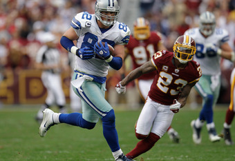 LANDOVER, MD - NOVEMBER 20: Jason Witten #82 of the Dallas Cowboys outruns DeAngelo Hall #23 of the Washington Redskins for a second half touchdown after catching a pass at FedExField on November 20, 2011 in Landover, Maryland.  (Photo by Rob Carr/Getty I