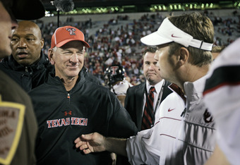 NORMAN, OK - OCTOBER 22:  Texas Tech Head Coach Tommy Tuberville and the Oklahoma Sooners Head Coach Bob Stoops meet after the game October 22, 2011 at Gaylord Family-Oklahoma Memorial Stadium in Norman, Oklahoma. Texas Tech upset Oklahoma 41-38. (Photo b