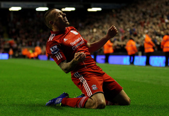 LIVERPOOL, ENGLAND - OCTOBER 22:  Craig Bellamy of Liverpool celebrates scoring the opening goal during the Barclays Premier League match between Liverpool and Norwich City at Anfield on October 22, 2011 in Liverpool, England.  (Photo by Richard Heathcote