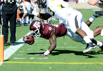COLLEGE STATION, TX - OCTOBER 29:  Cyrus Gray #32 of the Texas A&M Aggies is tackled on the two yard line during a game against the Missouri Tigers at Kyle Field on October 29, 2011 in College Station, Texas.  (Photo by Sarah Glenn/Getty Images)
