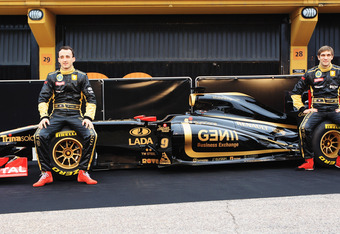 VALENCIA, SPAIN - JANUARY 31:  Robert Kubica (L) of Poland and Vitaly Petrov (R) of Russia attend the unveiling of the new Lotus Renault GP R31 at the Ricardo Tormo Circuit on January 31, 2011 in Valencia, Spain.  (Photo by Mark Thompson/Getty Images)