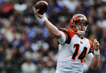BALTIMORE, MD - NOVEMBER 20: Quarterback Andy Dalton #14 of the Cincinnati Bengals throws against the Baltimore Ravens defenders in the third quarter at M&T Bank Stadium on November 20, 2011 in Baltimore, Maryland. The Ravens won, 31-24. (Photo by Patrick