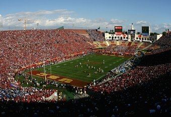 LOS ANGELES, CA - DECEMBER 01:  General view as the UCLA Bruins kick off to the USC Trojans to start the college football game at the Los Angeles Memorial Coliseum on December 1, 2007 in Los Angeles, California. The Trojans defeated the Bruins 24-7.  (Pho