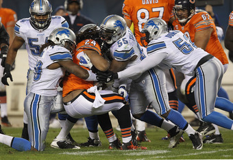 CHICAGO, IL - NOVEMBER 13:  Willie Young #79, Stephen Tulloch #55 and James Durant  #52 of the Detroit Lions stop Marion Barber #24 of the Chicago Bears at Soldier Field on November 13, 2011 in Chicago, Illinois. The Bears defeated the Lions 37-13.  (Phot