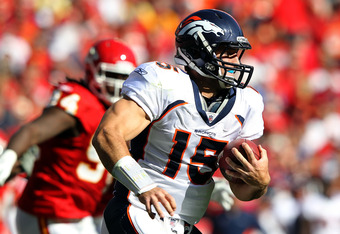 KANSAS CITY, MO - NOVEMBER 13:  Quarterback Tim Tebow #15 of the Denver Broncos carries the ball during the first half of the game against the Kansas City Chiefs on November 13, 2011 at Arrowhead Stadium in Kansas City, Missouri.  (Photo by Jamie Squire/G