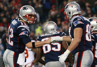 FOXBORO, MA - NOVEMBER 21:  Rob Gronkowski #87 of the New England Patriots celebrates his first touchdown with teammate  Tom Brady #12 at Gillette Stadium on November 21, 2011 in Foxboro, Massachusetts. (Photo by Jim Rogash/Getty Images)
