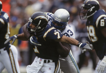 30 Dec 2001:  Quarterback Doug Flutie #7 of the San Diego Chargers is tackled by defensive tackle John Randle #93 of the Seattle Seahawks during the NFL game at Qualcomm Stadium in San Diego, California.  The Seahawks defeated the Chargers 25-22.  \ \ Man