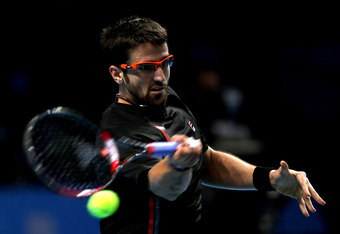 LONDON, ENGLAND - NOVEMBER 25:  Janko Tipsarevic of Serbia hits a forehand during the men's singles match against Novak Djokovic of Serbiaduring the Barclays ATP World Tour Finals at the O2 Arena on November 25, 2011 in London, England.  (Photo by Clive B