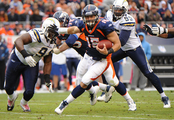 DENVER, CO - OCTOBER 9: Tim Tebow #15 of the Denver Broncos rushes the ball against the San Diego Chargers at Sports Authority Field at Mile High on October 9, 2011 in Denver, Colorado. The Chargers won 29-24. (Photo by Bart Young/Getty Images)