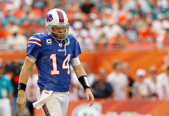 MIAMI GARDENS, FL - NOVEMBER 20:  Ryan Fitzpatrick #14 of the Buffalo Bills walks off the field during a game against the Miami Dolphins at Sun Life Stadium on November 20, 2011 in Miami Gardens, Florida.  (Photo by Mike Ehrmann/Getty Images)