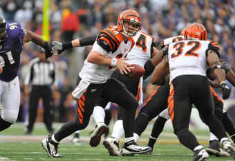 BALTIMORE - NOVEMBER 20:  Andy Dalton #14 of the Cincinnati Bengals hands off against the Baltimore Ravens at M&T Bank Stadium on November 20,  2011 in Baltimore, Maryland. The Ravens defeated the Bengals 31-24. (Photo by Larry French/Getty Images)