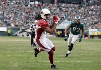 PHILADELPHIA, PA - NOVEMBER 13:  Larry Fitzgerald #11 of the Arizona Cardinals catches a tipped pass for a second half touchdown in front of  Jason Babin #93 of the Philadelphia Eagles at Lincoln Financial Field on November 13, 2011 in Philadelphia, Penns