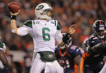 DENVER, CO - NOVEMBER 17:  Quarterback Mark Sanchez #6 of the New York Jets delivers a pass intended for Plaxico Burress #17 of the New York Jets that was intercepted by Andre' Goodman #21 of the Denver Broncos for a 26 yard touchdown at Sports Authority