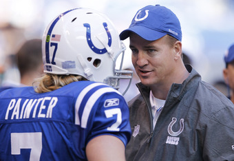 INDIANAPOLIS, IN - NOVEMBER 6: Peyton Manning of the Indianapolis Colts talks with quarterback Curtis Painter #7 during the game against the Atlanta Falcons at Lucas Oil Stadium on November 6, 2011 in Indianapolis, Indiana. The Falcons defeated the Colts
