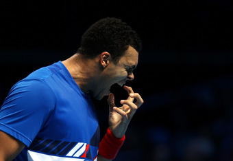 LONDON, ENGLAND - NOVEMBER 26:  Jo-Wilfried Tsonga of France celebrates winning the men's singles semi-final match against Tomas Berdych of Czech Republic during the Barclays ATP World Tour Finals at the O2 Arena on November 26, 2011 in London, England. T