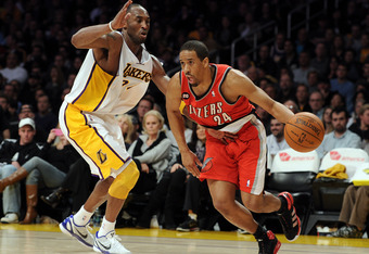 LOS ANGELES, CA - MARCH 20:  Andre Miller #24 of the Portland Trail Blazers dribbles around Kobe Bryant #24 of the Los Angeles Lakers at the Staples Center on March 20, 2011 in Los Angeles, California.  NOTE TO USER: User expressly acknowledges and agrees
