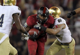 STANFORD, CA - NOVEMBER 26:  Stepfan Taylor #33 of the Stanford Cardinal runs the ball against the Notre Dame Fighting Irish at Stanford Stadium on November 26, 2011 in Stanford, California.  (Photo by Ezra Shaw/Getty Images)