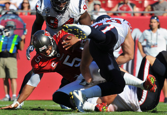 TAMPA, FL - NOVEMBER 13:  Defensive end J. J. Watt #99 of the Houston Texans sacks quarterback Josh Freeman #5 of the Tampa Bay Buccaneers November 13, 2011 at Raymond James Stadium in Tampa, Florida. (Photo by Al Messerschmidt/Getty Images)