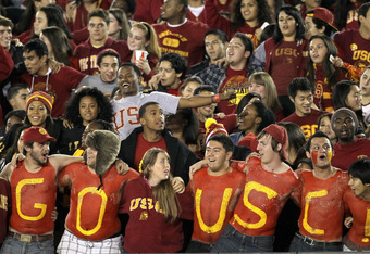 LOS ANGELES, CA - NOVEMBER 26: The USC student section celebrates during the game between the USC Trojans and the UCLA Bruins at the Los Angeles Memorial Coliseum on November 26, 2011 in Los Angeles, California. USC won 50-0.  (Photo by Stephen Dunn/Getty