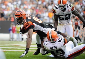 CLEVELAND, OH - SEPTEMBER 11: Tight end Jermaine Gresham #84 of the Cincinnati Bengals catches a two yard pass for a touchdown over defensive back  T.J. Ward #43 and linebacker D'Qwell Jackson of the Cleveland Browns during the first quarter at Cleveland
