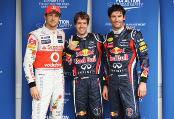 SAO PAULO, BRAZIL - NOVEMBER 26:  Pole sitter Sebastian Vettel (C) of Germany and Red Bull Racing celebrates in parc ferme with second placed Mark Webber (R) of Australia and Red Bull Racing and third placed Jenson Button (L) of Great Britain and McLaren