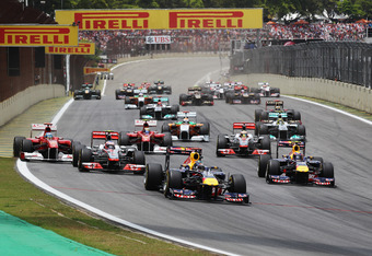 SAO PAULO, BRAZIL - NOVEMBER 27:  Sebastian Vettel (C) of Germany and Red Bull Racing leads the field to the first corner at the start of the Brazilian Formula One Grand Prix at the Autodromo Jose Carlos Pace on November 27, 2011 in Sao Paulo, Brazil.  (P