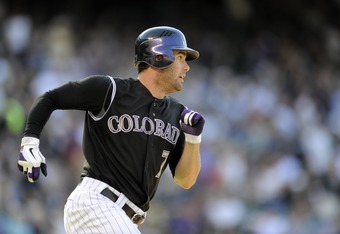 DENVER, CO - SEPTEMBER 10: Seth Smith #7 of the Colorado Rockies runs against the Cincinnati Reds at Coors Field on September 10, 2011 in Denver, Colorado. Colorado beat Cincinnati 12-7.  (Photo by Jack Dempsey/Getty Images)