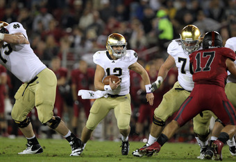 STANFORD, CA - NOVEMBER 26:  Andrew Hendrix #12 of the Notre Dame Fighting Irish runs with the ball against the Stanford Cardinal at Stanford Stadium on November 26, 2011 in Stanford, California.  (Photo by Ezra Shaw/Getty Images)