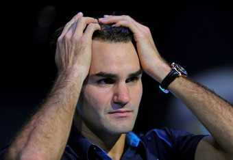 LONDON, ENGLAND - NOVEMBER 27:  Roger Federer of Switzerland reacts following his victory during the men's final singles match against Jo-Wilfried Tsonga of France during the Barclays ATP World Tour Finals at the O2 Arena on November 27, 2011 in London, E