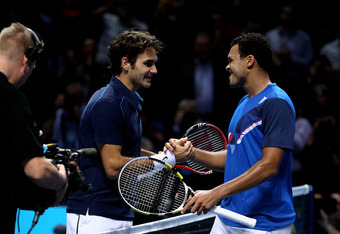 LONDON, ENGLAND - NOVEMBER 27:  Roger Federer (L) of Switzerland is congratulated by opponent Jo-Wilfried Tsonga of France following his victory in the men's final singles match during the Barclays ATP World Tour Finals at the O2 Arena on November 27, 201