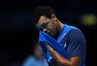 LONDON, ENGLAND - NOVEMBER 27:  Jo-Wilfried Tsonga of France reacts during the men's final singles match against Roger Federer of Switzerland during the Barclays ATP World Tour Finals at the O2 Arena on November 27, 2011 in London, England.  (Photo by Cli
