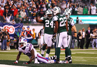 EAST RUTHERFORD, NJ - NOVEMBER 27:   Steve Johnson #13 of the Buffalo Bills lies on the ground as  Darrelle Revis #24, Brodney Pool #22, and Jim Leonhard #36 of the New York Jets celebrate a broken up pass after the last play of the game with the Jets win