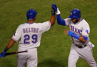 ST LOUIS, MO - OCTOBER 28:  Elvis Andrus #1 (R) of the Texas Rangers celebrates with Adrian Beltre #29 after scoring on an RBI double by Josh Hamilton #32 in the first inning during Game Seven of the MLB World Series against the St. Louis Cardinals at Bus
