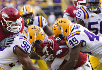 BATON ROUGE, LA - NOVEMBER 25:   Barkevious Mingo #49 and Sam Montgomery #99 of the LSU Tigers sack Tyler Wilson #8 of the Arkansas Razorbacks at Tiger Stadium on November 25, 2011 in Baton Rouge, Louisiana.  The Tigers defeated the Razorbacks 41 to 17.