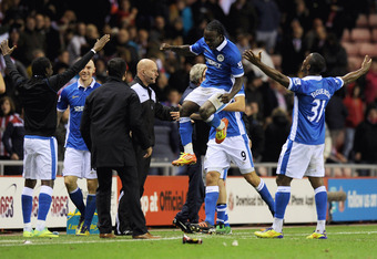 Wigan players celebrate as Franco Di Santo grabs a late Winner against Sunderland.