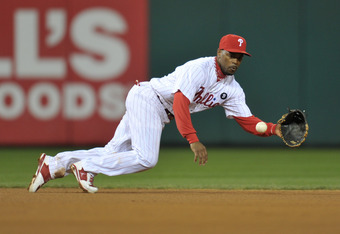 PHILADELPHIA, PA - OCTOBER 02: Jimmy Rollins #11 of the Philadelphia Phillies fields the ball during Game Two of the National League Division Series against the St. Louis Cardinals at Citizens Bank Park on October 2, 2011 in Philadelphia, Pennsylvania. Th